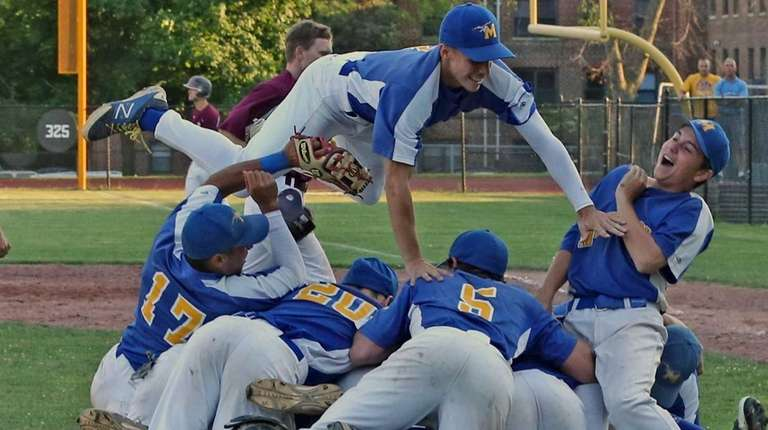 Mattituck players celebrate after they defeated Albertus Magnus,