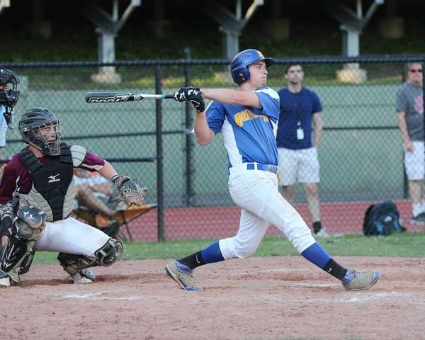 Chris Dwyer of Mattituck hits a long fly