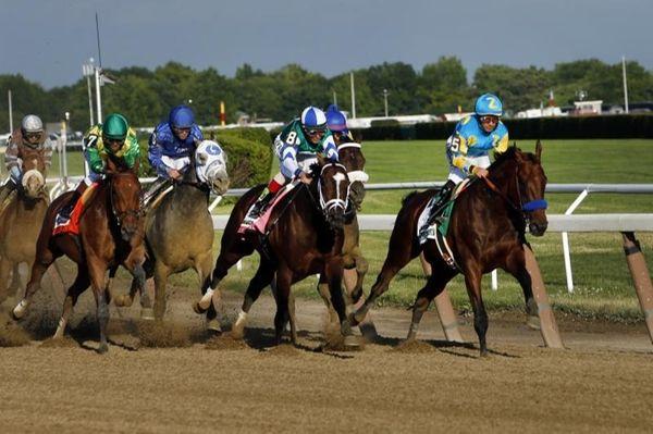 American Pharoah (5), far right, leads the field