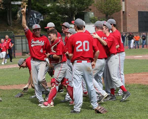 Southold celebrates its win over Tuckahoe in the