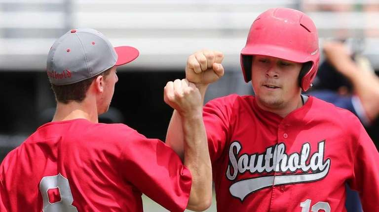 Southold pitcher Alexander Poliwoda is congratulated by a