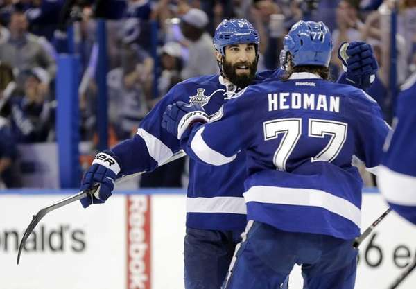 Tampa Bay Lightning defenseman Jason Garrison, left, celebrates