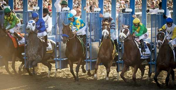 American Pharoah, center breaking out of the gate