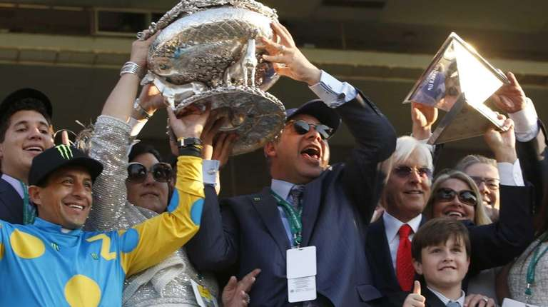American Pharoah jockey Victor Espinoza, left, and owner