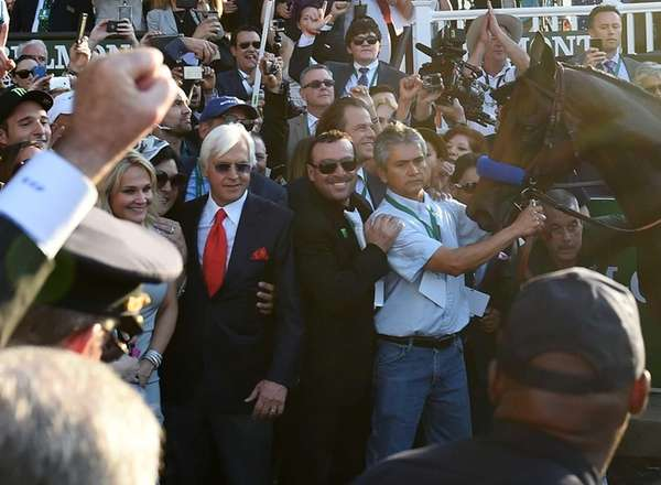 Bob Baffert celebrates with American Pharoah after winning