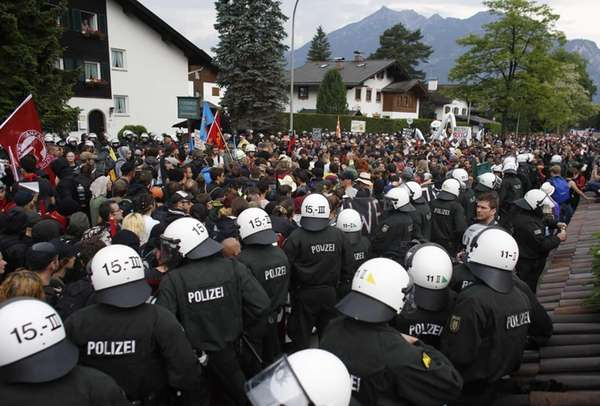 Police stand beside demonstrators during a protest march