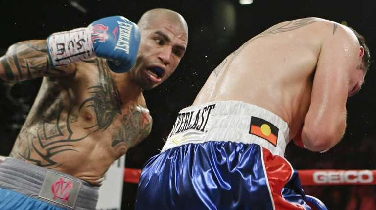 Miguel Cotto, left, of Puerto Rico, punches Daniel