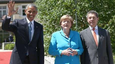 President Barack Obama is greeted by Germany's Chancellor