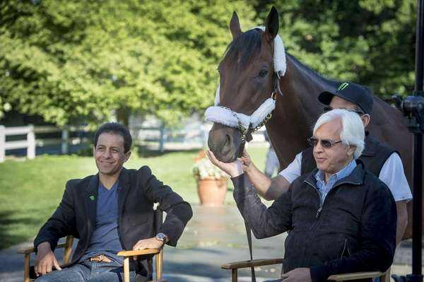 American Pharoah jockey Victor Espinoza, left, and trainer