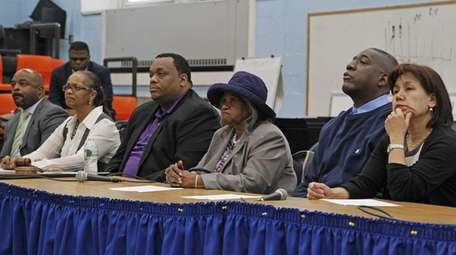 From left, Hempstead school district attorney Monte Malik