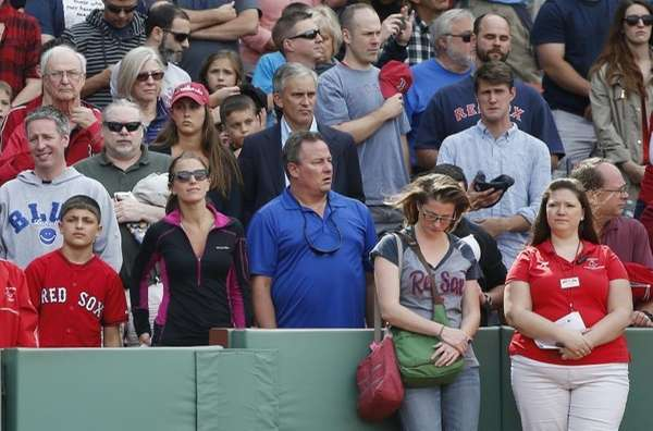 Fans observe a moment of silence before a