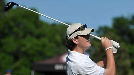 Mike Brennan of St. Dominic tees off on