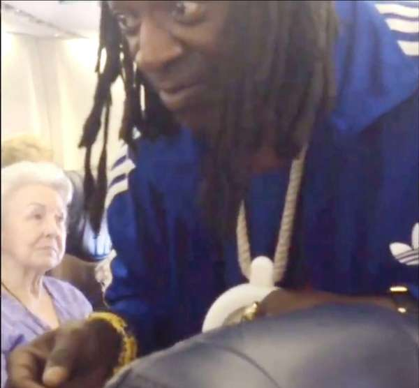 Long Island native Flavor Flav hands out peanuts