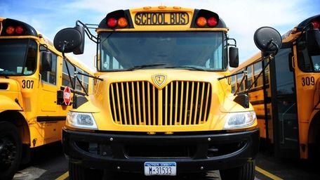 A school bus in a bus depot.