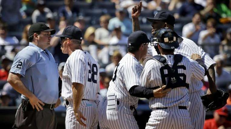 Teammates hold back New York Yankees starting pitcher