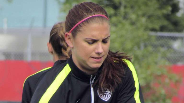 U.S. women's soccer team forward Alex Morgan stretches