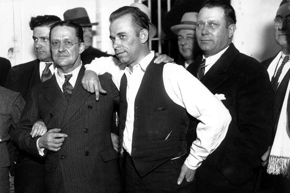 Gangster John Dillinger, center, with Lake County prosecutor