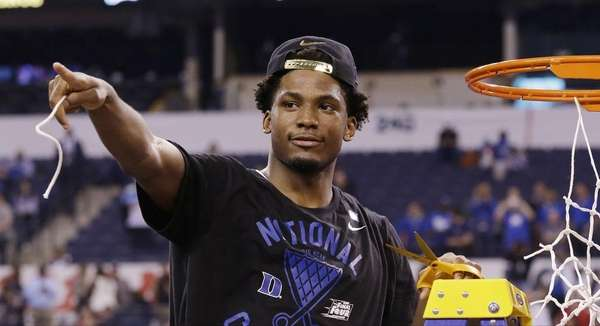 Duke's Justise Winslow cuts down the net after