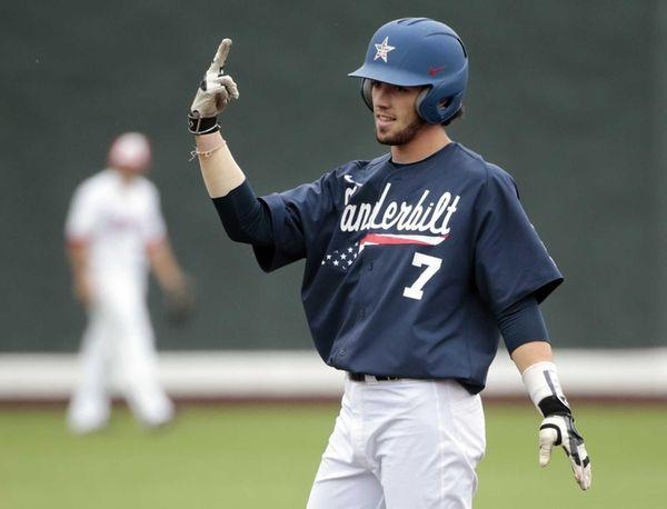 Vanderbilt's Dansby Swanson celebrates on second base after
