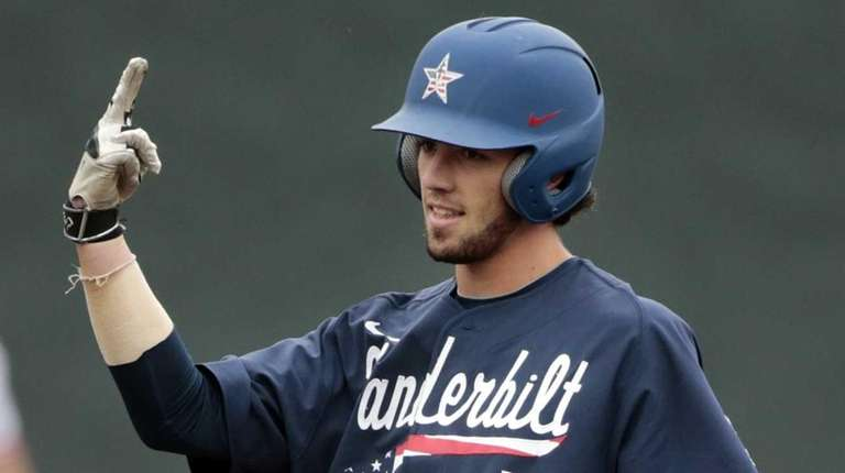 Vanderbilt's Dansby Swanson celebrates on second base after