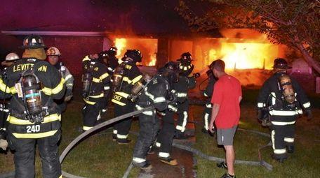 Firefighters battle a blaze on Wadsworth Avenue in