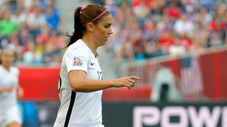 Alex Morgan #13 of the United States dribbles