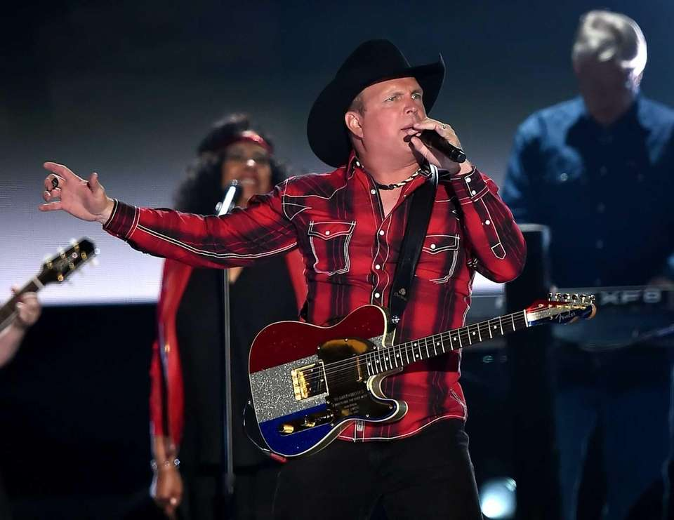Honoree Garth Brooks performs during the 50th Academy