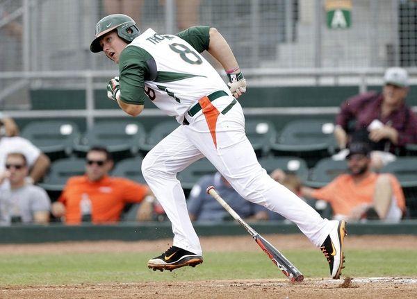 Miami's David Thompson (8) heads to first base