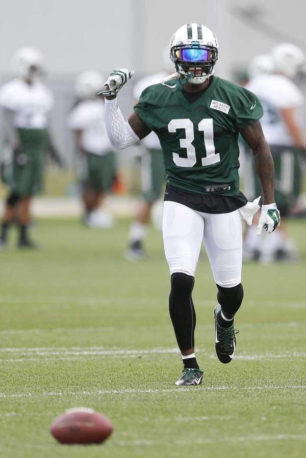 New York Jets cornerback Antonio Cromartie laughs after