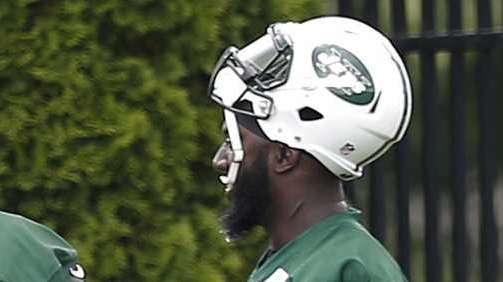 New York Jets defensive end Muhammad Wilkerson, right,