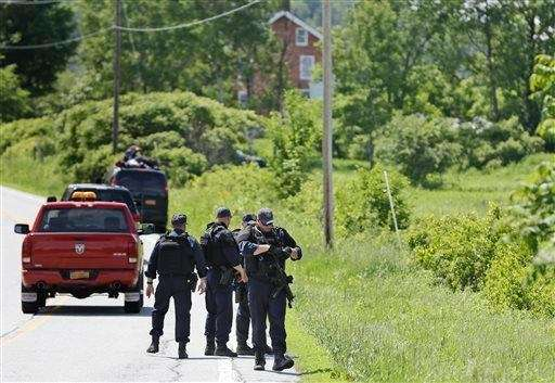 Heavily armed law enforcement agents patrol the edge