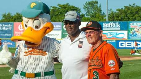 George Foster, center, poses with Quacker Jack and