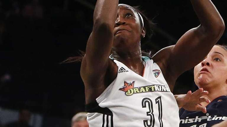 New York Liberty's Tina Charles goes to the