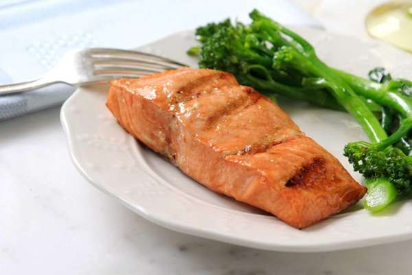 Salmon is grilled and brushed with a glaze