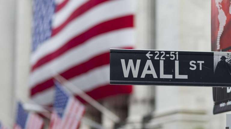 A Wall Street sign hangs near the New