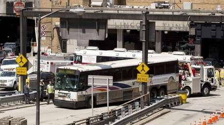 A New Jersey Transit bus is pushed by