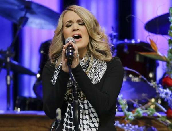 Carrie Underwood performs during the funeral service for