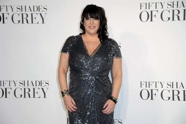 E L James posing for photographers at the