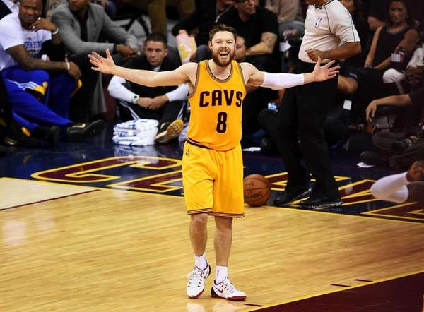 Matthew Dellavedova of the Cleveland Cavaliers reacts during
