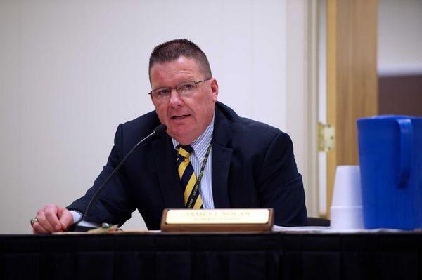 Sachem Superintendent James Nolan speaks at a school