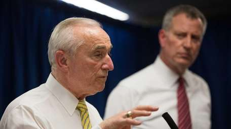 New York City Police Commissioner William Bratton, left,