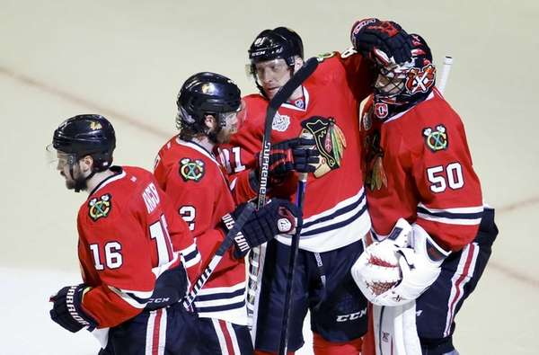 Chicago Blackhawks' Duncan Keith, Marcus Kruger, Marian Hossa