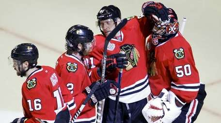 Chicago Blackhawks' Duncan Keith, Marcus Kruger, Marian Hossa