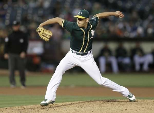 Oakland Athletics pitcher Pat Venditte works against the