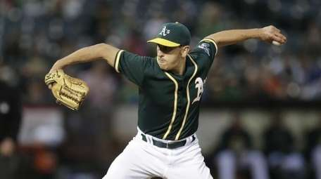 Oakland Athletics pitcher Pat Venditte works against the