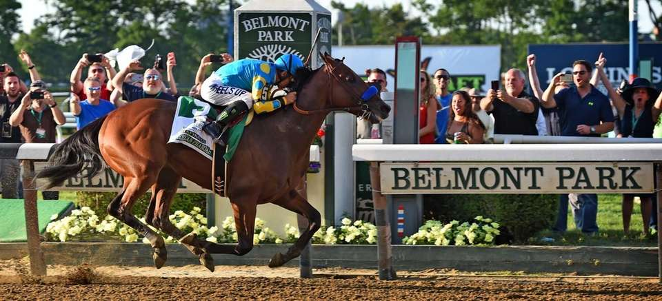 Victor Espinoza rides atop American Pharoah as they