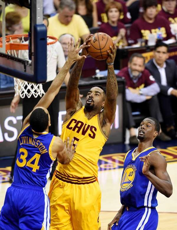 J.R. Smith of the Cleveland Cavaliers shoots against