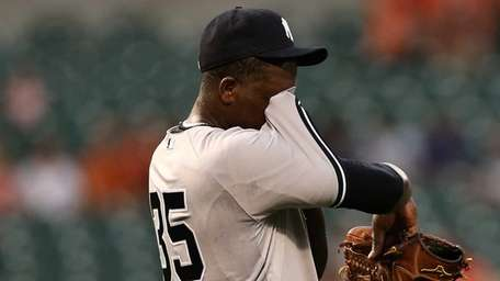 Starting pitcher Michael Pineda of the Yankees wipes