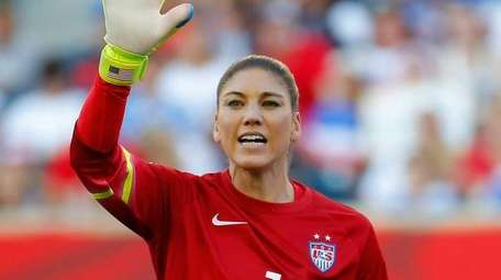 Goalkeeper Hope Solo of the United States stands