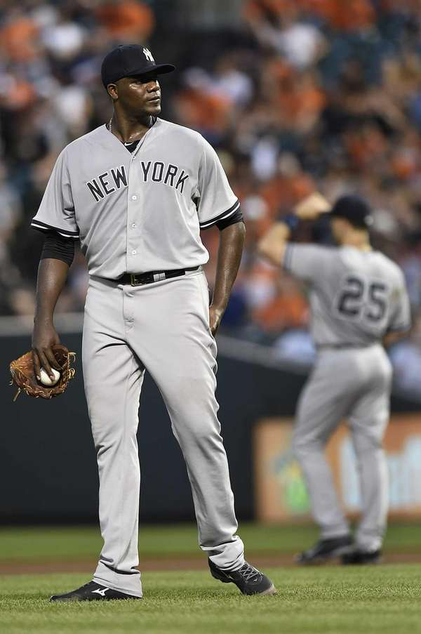 Yankees starting pitcher Michael Pineda pauses after giving